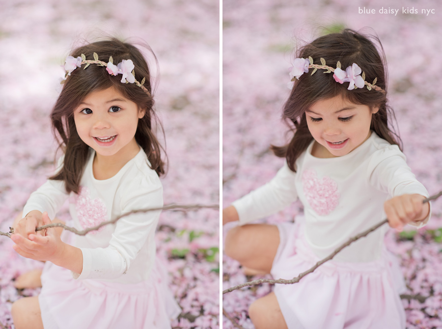 toddler playing under cherry blossom trees